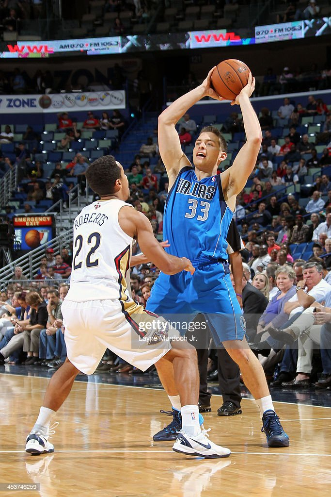 <a gi-track='captionPersonalityLinkClicked' href=/galleries/search?phrase=Gal+Mekel&family=editorial&specificpeople=6141738 ng-click='$event.stopPropagation()'>Gal Mekel</a> #33 of the Dallas Mavericks looks to pass against Brian Roberts #22 of the New Orleans Pelicans on December 4, 2013 at the New Orleans Arena in New Orleans, Louisiana.