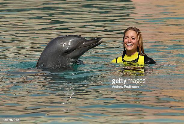 Gala Alten girlfriend of Pablo Larrazabal swims with a dolphin during a European Tour players' family event at Dolphin Bay Atlantis prior to the...