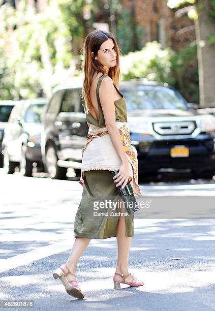 Gala Gonzalez is seen in the East Village wearing a Datura dress vintage jacket from India Purification Garcia sandals and a Baraboux clutch bag on...