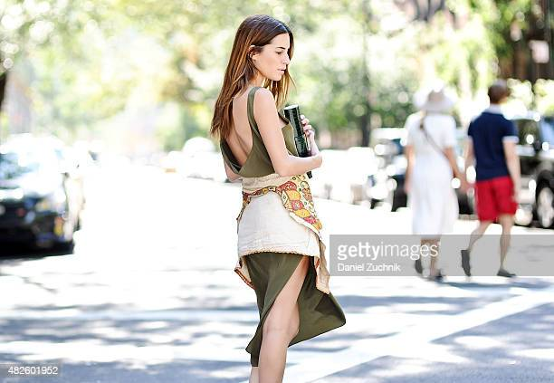 Gala Gonzalez is seen in the East Village wearing a Datura dress vintage jacket from India and a Baraboux clutch bag on July 31 2015 in New York City
