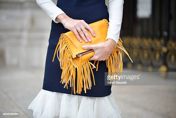 Gala Gonzalez poses wearing a Caroline Herrera dress and bag on Day 7 of Paris Fashion Week Womenswear FW15 on March 9 2015 in Paris France