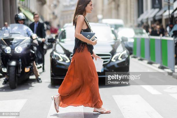 Gala Gonzalez wearing a red brown jumpsuit black top with fringes sandals outside Elie Saab during Paris Fashion Week Haute Couture Fall/Winter...