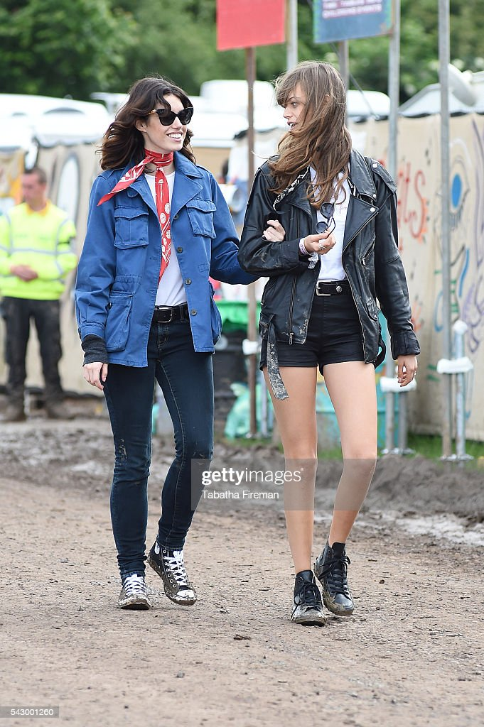 Gala Gordon (L) and friend wear Converse at Glastonbury Festival 2016 at Glastonbury Festival Site on June 25, 2016 in Glastonbury, England.