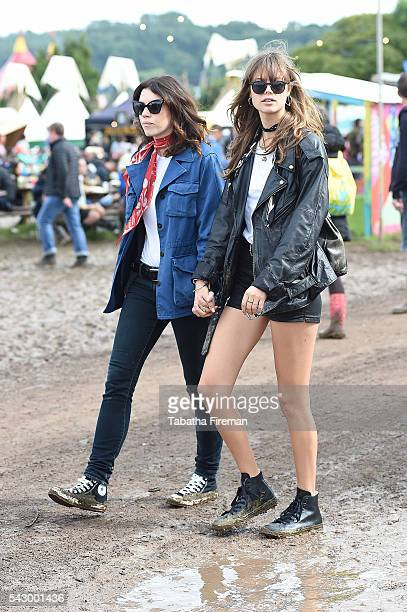 Gala Gordon and model Jessica Clarke wear Converse at Glastonbury Festival 2016 at Glastonbury Festival Site on June 25 2016 in Glastonbury England