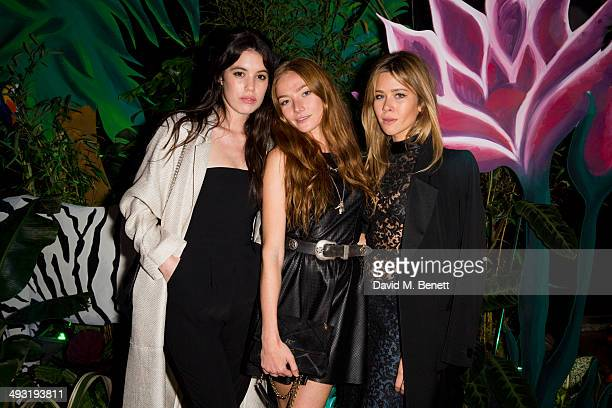 Gala Gordon Clara Paget and Jazzy de Lisser arrive at Roger Vivier Summer Party at Loulou's on May 22 2014 in London England