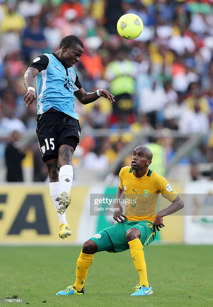 Galabgwe Moyana heads the ball away from Anele Ngcongca of South Africa during the 2014 FIFA World Cup Qualifier match between South Africa and Botswana from Moses Mabhida Stadium on September 07, 2013 in Durban, South Africa.
