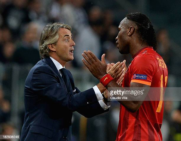 Galatasaray AS coach Roberto Mancini has words with Didier Drogba during UEFA Champions League Group B match between Juventus and Galatasaray AS at...