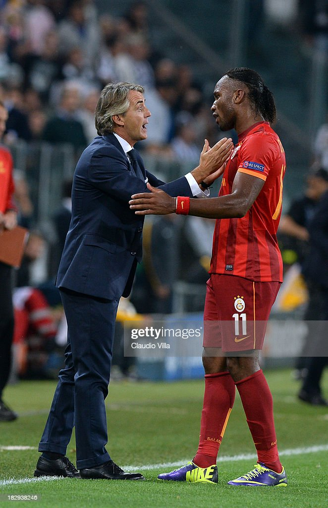 Galatasaray AS coach Roberto Mancini (L) has words with Didier Drogba during UEFA Champions League Group B match between Juventus and Galatasaray AS at Juventus Arena on October 2, 2013 in Turin, Italy.