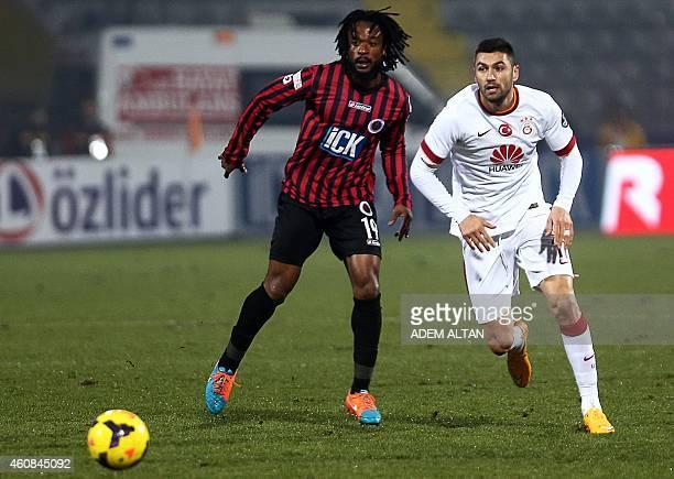 Galatasaray Burak Yilmaz vies for the ball with Genclerbirligi's JeanJacques Gosso during the Turkish Super League football between Genclerbirligi...