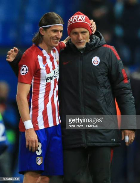 Galatasaray coach Claudio Taffarel and Atletico Madrid's Filipe Luis