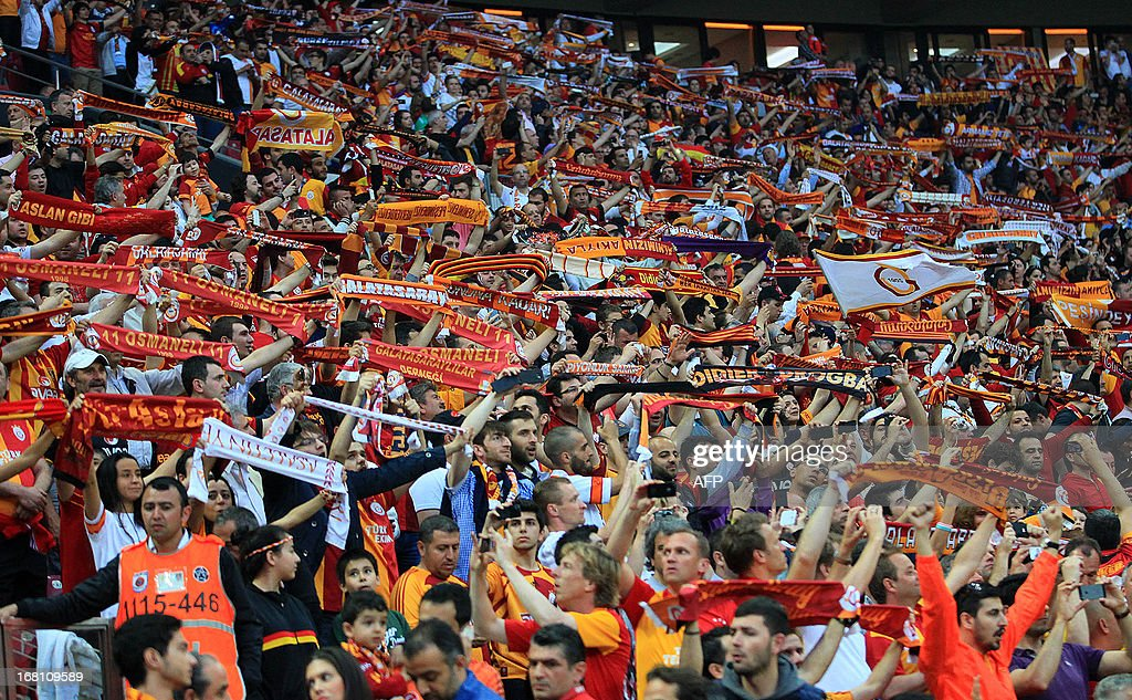 Galatasaray fans hold scarfs as they support their team during the Turkish super league football match between Galatasay and Sivasspor on May 5, 2013 at Turk Telekom Arena, in Istanbul.