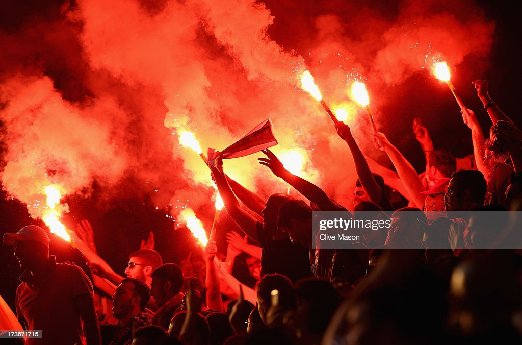 Galatasaray fans light flares during the pre season friendly match between Notts County and Galatasaray at Meadow Lane on July 16, 2013 in Nottingham, England.