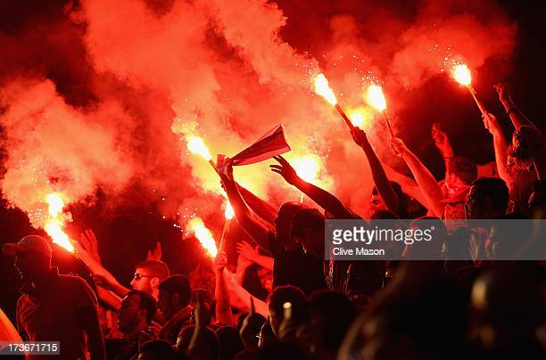 Galatasaray fans light flares during the pre season friendly match between Notts County and Galatasaray at Meadow Lane on July 16 2013 in Nottingham...