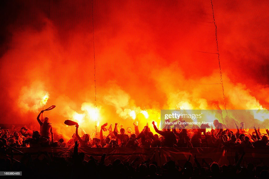 Galatasaray fans light flares during the UEFA Champions League Quarter Final first leg match between Real Madrid and Galatasaray at Estadio Santiago Bernabeu on April 3, 2013 in Madrid, Spain.