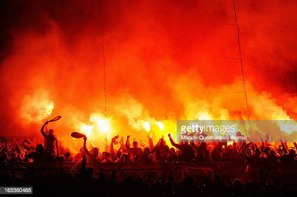 Galatasaray fans light flares during the UEFA Champions League Quarter Final first leg match between Real Madrid and Galatasaray at Estadio Santiago...