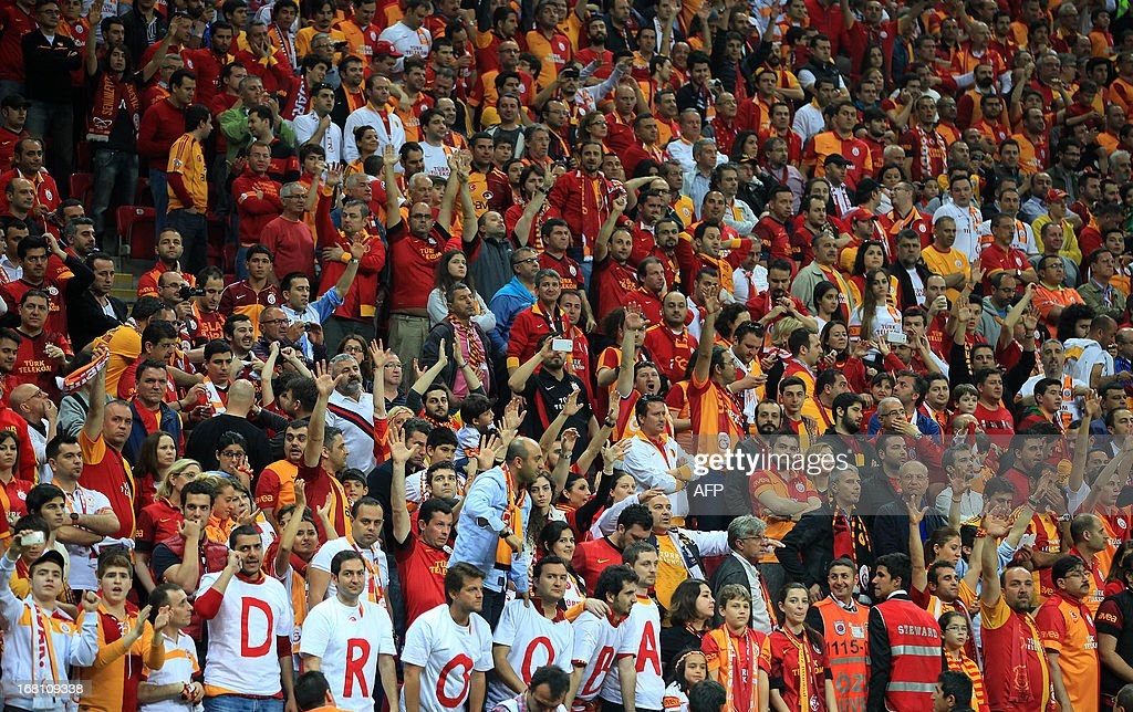 Galatasaray fans support their team during the Turkish super league football match between Galatasay and Sivasspor on May 5, 2013 at Turk Telekom Arena, in Istanbul.