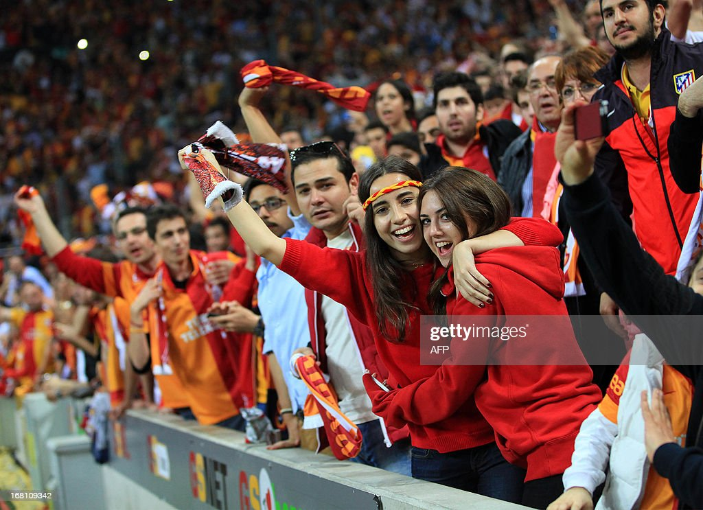 Galatasaray fans support their team during the Turkish super league football match between Galatasay and Sivasspor on May 5, 2013 at Turk Telekom Arena, in Istanbul. AFP PHOTO/MIRA