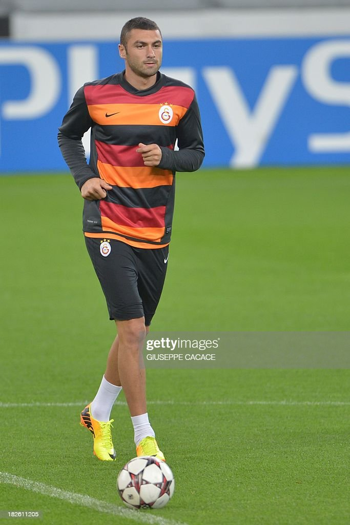Galatasaray forward Burak Yilmaz attends a training session on the eve of the Champion's League football match Juventus vs Galatasaray on October 1, 2013 in Turin.