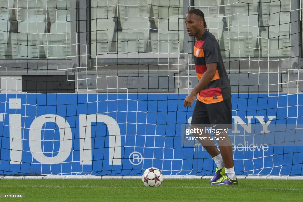 Galatasaray forward Didier Drogba attends a training session on the eve of the Champion's League football match Juventus vs Galatasaray on October 1, 2013 in Turin. Mancini, sacked by Manchester City at the end of last season following a shock defeat to Wigan in the final of the FA Cup, signed a three-year contract to manage the struggling Turkish champions.