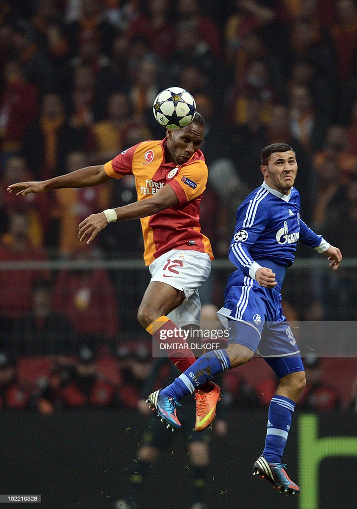 Galatasaray forward Didier Drogba (L) heads the ball next to FC Schalke 04 defender Sead Kolasinac (R) during the UEFA Champions League football match Galatasaray vs FC Schalke 04 at the Ali Samiyen stadium in Istanbul on February 20, 2013. AFP PHOTO / DIMITAR DILKOFF