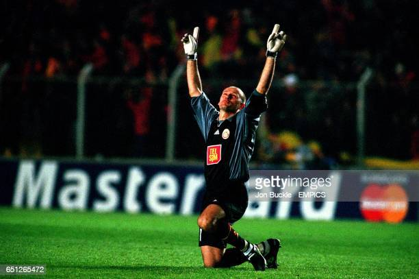 Galatasaray goalkeeper Claudio Taffarel celebrates as his teammates pull the score back from 02 to win 32