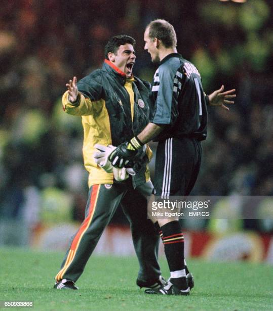 Galatasaray goalkeeper Claudio Taffarel celebrates with Faruk at the final whistle
