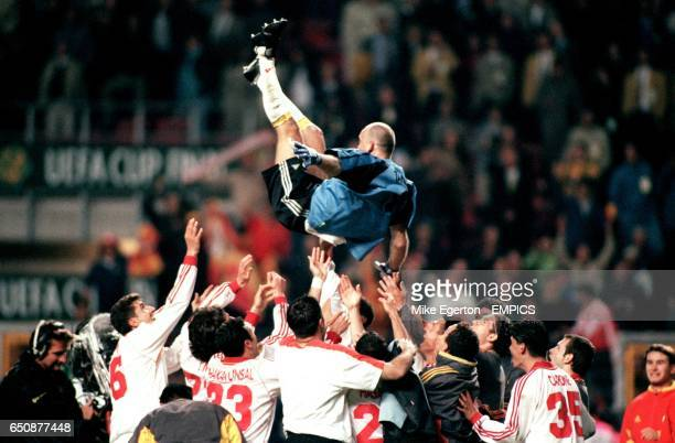Galatasaray goalkeeper Claudio Taffarel is thrown into the air in celebration after their victory