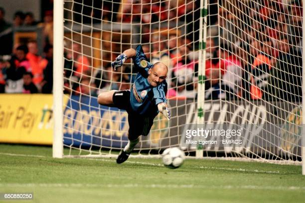Galatasaray goalkeeper Claudio Taffarel sees Davor Suker's penalty hit the post