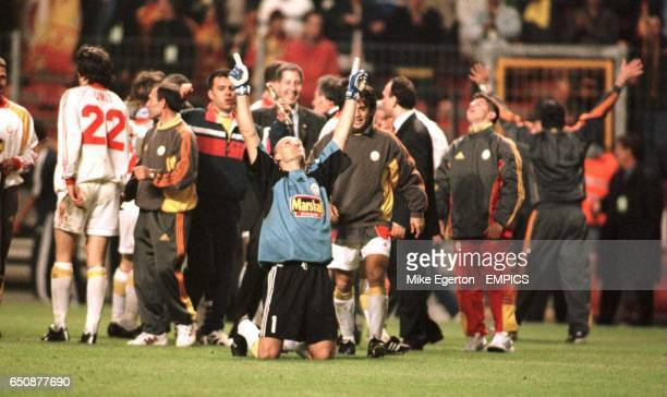 Galatasaray goalkeeper Claudio Taffarel sinks to his knees to celebrate victory