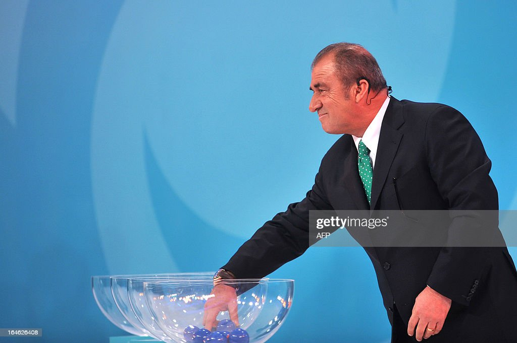 Galatasaray head coah Fatih Terim draws teams on March 25 ,2013 during the draw for the FIFA U-20 World Cup Turkey 2013 in istanbul. The FIFA U-20 World Cup will be held in Turkey between June 21 and July 13.