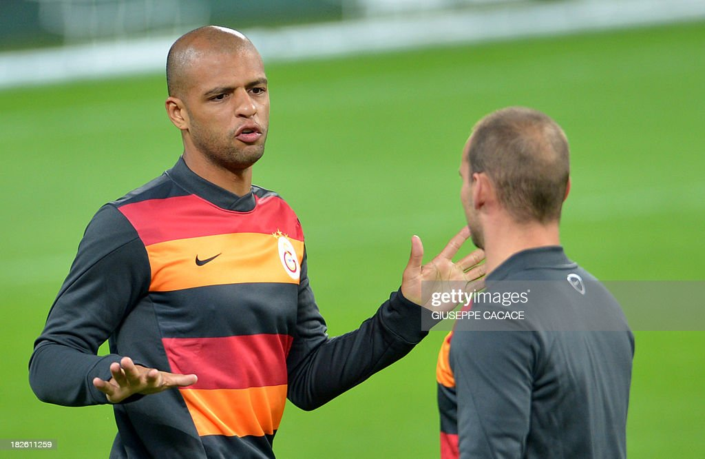 Galatasaray midfielder Felipe Melo (L) speaks with teammate Wesley Sneijder during a training session on the eve of the Champion's League football match Juventus vs Galatasaray on October 1, 2013 in Turin.