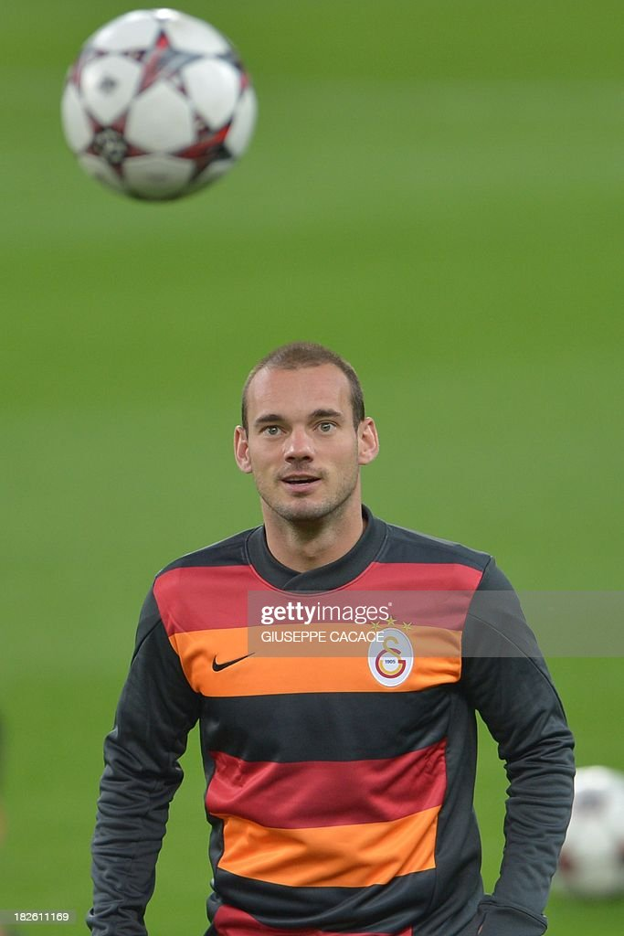 Galatasaray midfielder Wesley Sneijder attends a training session on the eve of the Champion's League football match Juventus vs Galatasaray on October 1, 2013 in Turin. Mancini, sacked by Manchester City at the end of last season following a shock defeat to Wigan in the final of the FA Cup, signed a three-year contract to manage the struggling Turkish champions. AFP PHOTO / GIUSEPPE CACACE