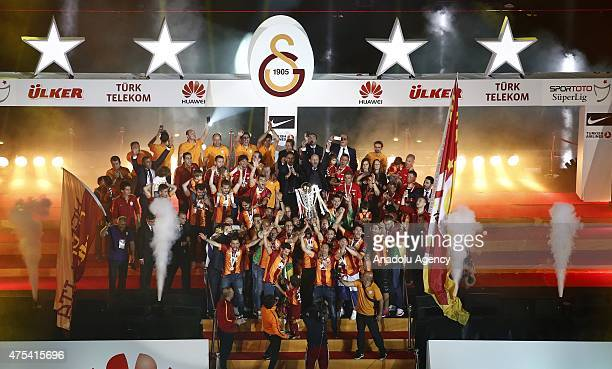 Galatasaray players celebrate with the trophy after winning the Turkish Spor Toto Super League title at Turk Telekom Arena in Istanbul Turkey on May...