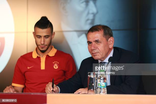 Galatasaray Sports Club President Dursun Ozbek and Galatasaray's new signing Younes Belhanda are seen during signing ceremony at Turk Telekom Stadium...