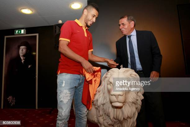 Galatasaray Sports Club President Dursun Ozbek and new signing Younes Belhanda pose after contract signing ceremony at Turk Telekom Stadium in...