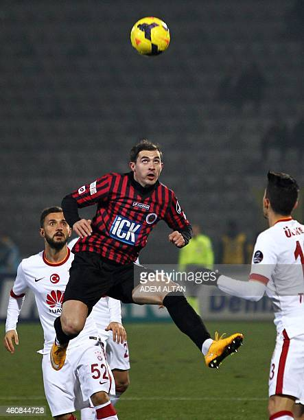 Galatasaray's Alex Nicolao Telles vies for the ball with Genclerbirligi's Bogdan Stancu during the Turkish Super League football between...