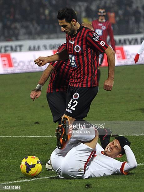 Galatasaray's Alex Telles falls next to Genclerbirligi's Hakan Aslantas during the Turkish Super League football between Genclerbirligi and...
