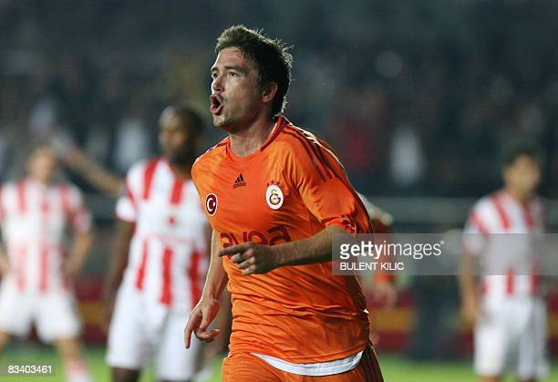 Galatasaray's Australian winger Harry Kewell celebrates his goal against Olympiakos during their UEFA Cup soccer match at the Ali Sami Yen Stadium in...