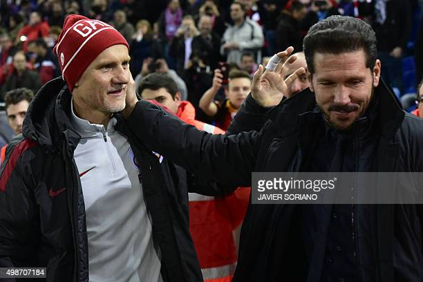 Galatasaray's Brazilian coach Claudio Taffarel greets to Atletico Madrid's Argentinian coach Diego Simeone during the UEFA Champions League Group C...