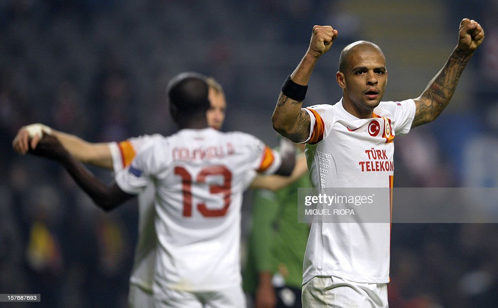Galatasaray's Brazilian midfielder Felipe Melo (R) celebrates at the end of the UEFA Champions League Group H football match SC Braga vs Galatasaray at the AXA Stadium in Braga, northern Portugal, on December 5, 2012. Galatasaray won the match 2-1. AFP PHOTO / MIGUEL RIOPA