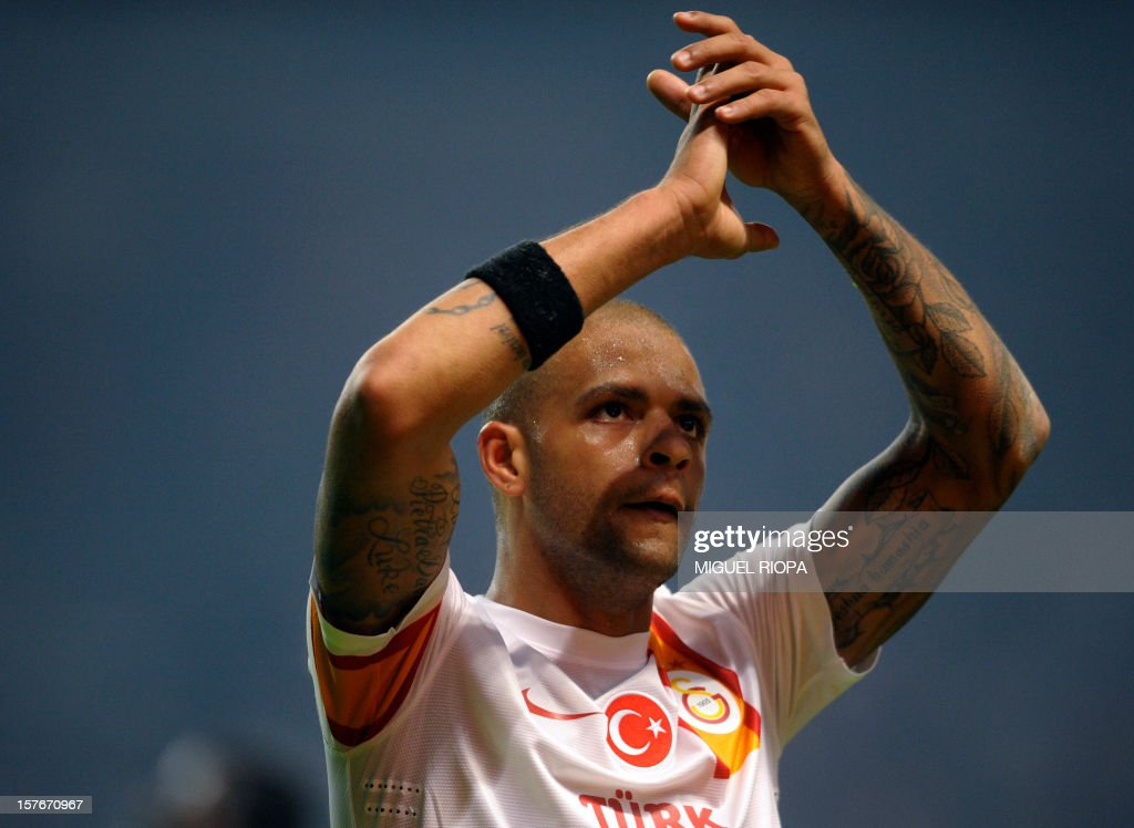 Galatasaray's Brazilian midfielder Felipe Melo waves to his supporters at the end of the UEFA Champions League Group H football match SC Braga vs Galatasaray at the AXA Stadium in Braga, northern Portugal, on December 5, 2012. Galatasaray won the match 2-1. AFP PHOTO / MIGUEL RIOPA