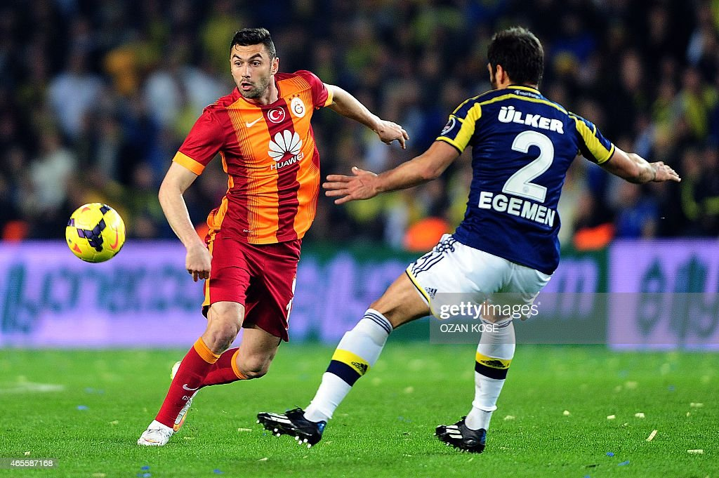 Galatasaray's <a gi-track='captionPersonalityLinkClicked' href=/galleries/search?phrase=Burak+Yilmaz&family=editorial&specificpeople=8254293 ng-click='$event.stopPropagation()'>Burak Yilmaz</a> (L) vies for the ball with Fenerbahce's Egemen Korkmaz (R) during the Turkish Sport Toto Super League football match Fenerbahce vs Galatasaray at the Fenerbahce Sukru Saracoglu Stadium, in Istanbul, on March 8, 2015.