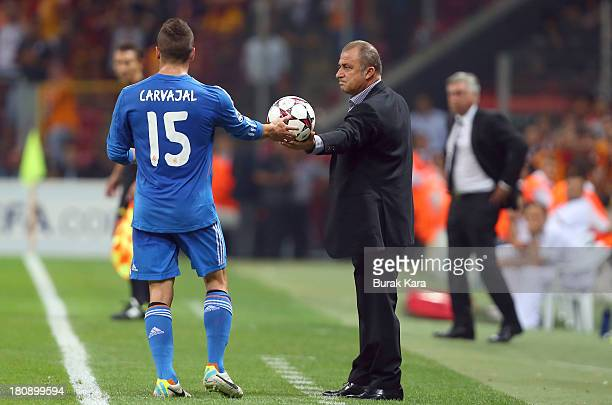 Galatasaray's coach Fatih Terim gives the ball to Real Madrid's Daniel Carvajal during UEFA Champions League Group B match at the Ali Sami Yen Area...
