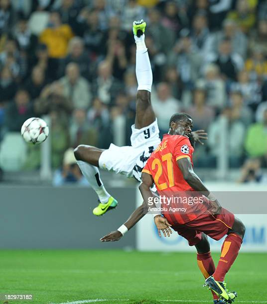 Galatasaray's Emmanuel Eboue vies with Juventus' midfielder Paul Pogba during the UEFA Champions League group B soccer match between Juventus and...