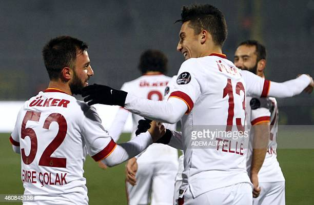 Galatasaray's Emre Colak is congratulated by Galatasaray's Alex Telles after scoring a goal during the Turkish Super League football between...