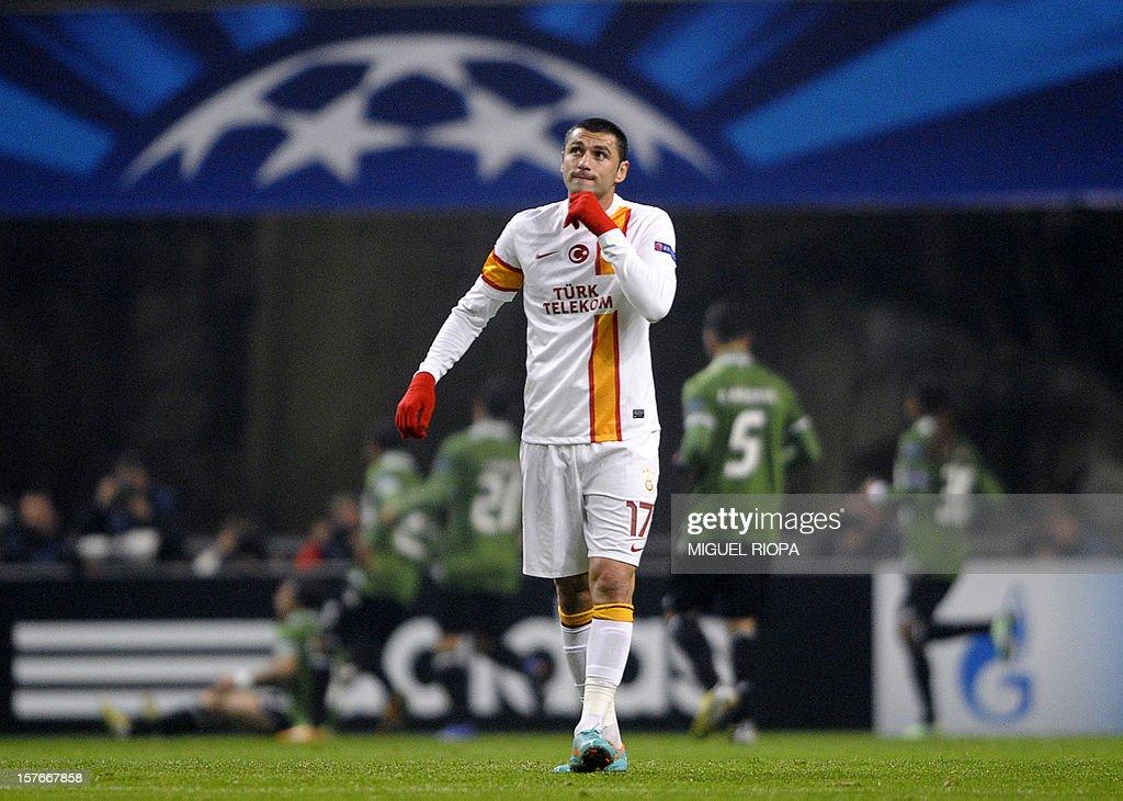 Galatasaray's forward Burak Yilmaz reacts after SC Braga scored during the UEFA Champions League Group H football match SC Braga vs Galatasaray at the AXA Stadium in Braga, northern Portugal, on December 5, 2012.