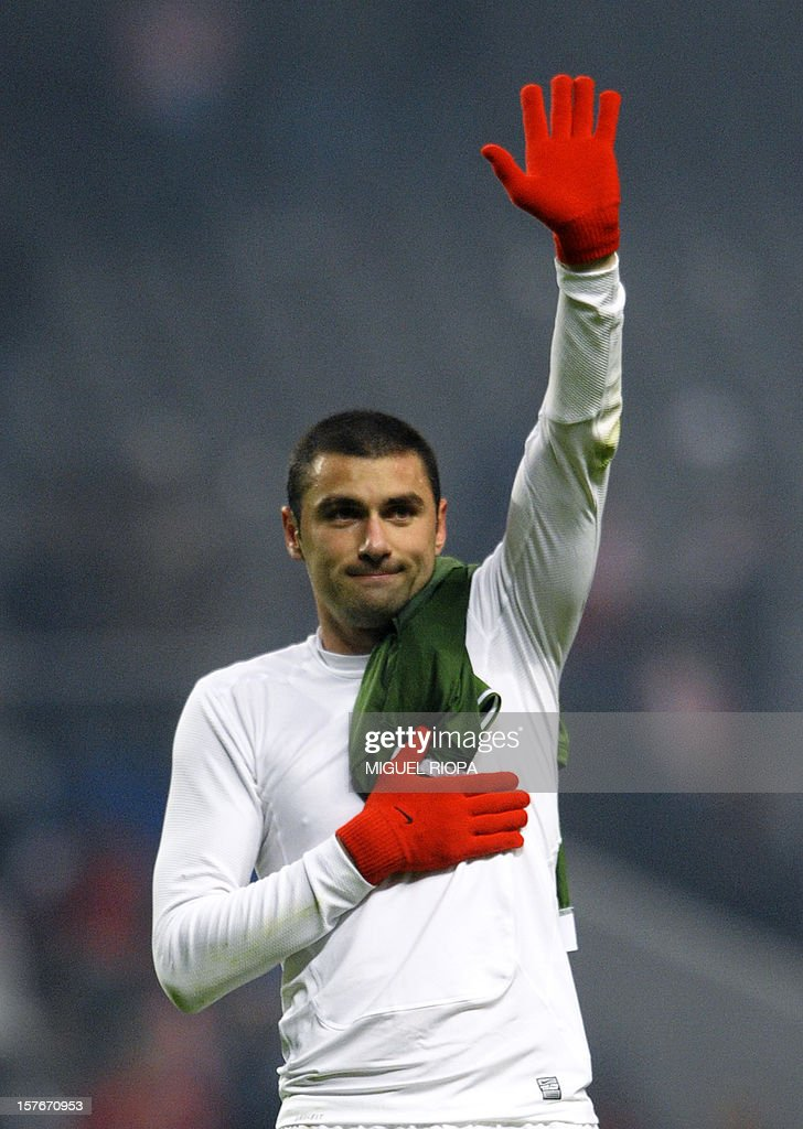 Galatasaray's forward Burak Yilmaz waves to his supporters at the end of the UEFA Champions League Group H football match SC Braga vs Galatasaray at the AXA Stadium in Braga, northern Portugal, on December 5, 2012. Galatasaray won the match 2-1.