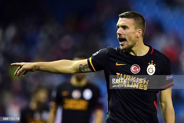 Galatasaray's German forward Lukas Podolski gestures during the UEFA Champions League Group C football match Club Atletico de Madrid vs Galatasaray...