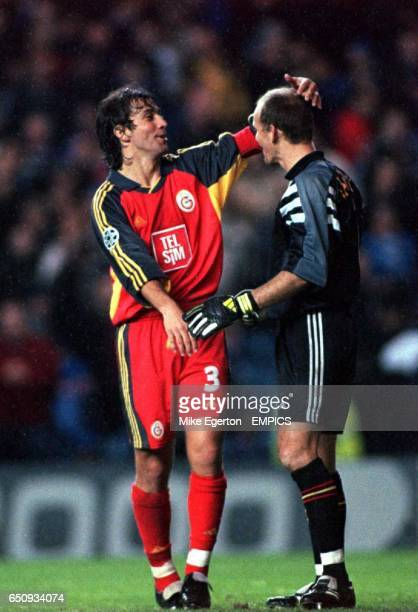 Galatasaray's goalkeeper Claudio Taffarel is congratulated by teammate Bulent Korkmaz at the final whistle