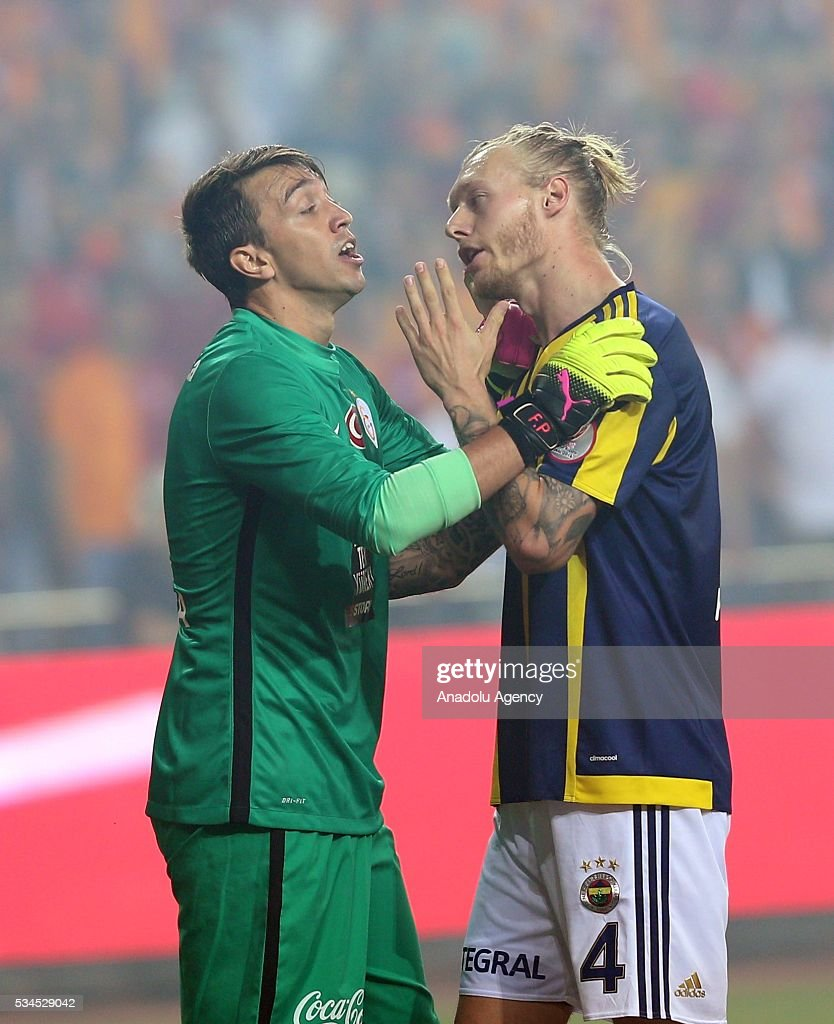 Galatasaray's goalkeeper Fernando Muslera (L) argues with Fenerbahce's Simon Kjaer (R) during the Ziraat Turkish Cup Final match between Galatasaray and Fenerbahce at Antalya Ataturk Stadium in Antalya, Turkey on May 26, 2016.
